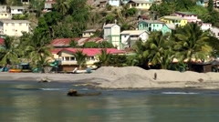St. Lucia Caribbean Sea 138 boat ride along an empty village beach Stock Footage