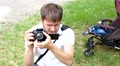 Man shooting with photo camera while his child sleeping in buggy 4k or 4k+ Resolution