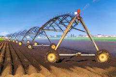 Automated Farming Irrigation Sprinklers System in Operation Stock Photos