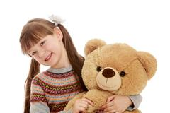 Charming girl with tails hugging a Teddy bear - stock photo