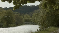 Static view of footbridge over the River Tweed, Peebles. Stock Footage
