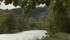 Panning upward to view the river Tweed in Peebles, Scotland - stock footage
