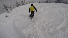 Stock Video Footage of Snowboarder going downhill camera in pursuit