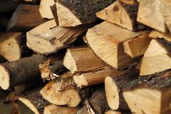 Stack of dry chopped firewood. Background of a pile - stock photo