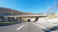 Fast Car driving through tunnel at the entrance to Rijeka Stock Footage