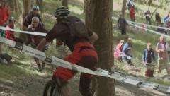 Mountain biker crashing during a race, Scotland Stock Footage