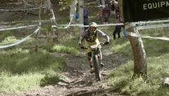 Single mountain biker racing through the forest. Stock Footage