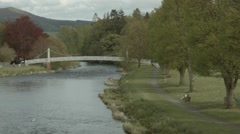 Satic view overlooking a bridge and the River Tweed, Peebles, Scotland Stock Footage