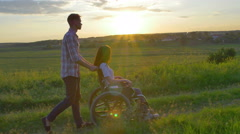 4 in 1 video! Man carry invalid woman in the wheelchair. Social video Stock Footage