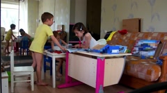 Three children playing in the room with the designer Stock Footage