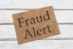 Stock Photo of Fraud Alert Warning Card