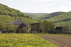 farm house with mountains in the background - stock photo