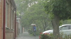 A man with an umbrella in the rain comes Stock Footage