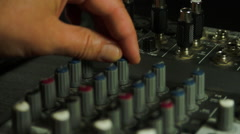 Editor's Hand Adjusting Sound Level On Mixer, Media, Technology, Sound Equipment Stock Footage
