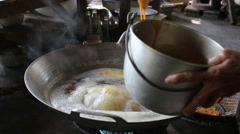 Cooking Thai snack Foi Thong - stock footage