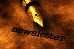 Fountain pen on newsletter  text - stock photo