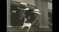 Vintage 16mm film, Columbia 1938, train stop selling food Stock Footage