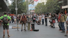 Street musician performer and audience in Melbourne Australia Stock Footage