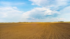 Spring plowed field, panoramic time-lapse Stock Footage