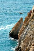 Group of cliff divers in free fly, Acapulco, Mexico. Stock Photos