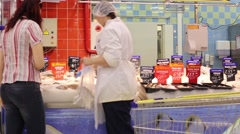 Woman and Seller Choose Fish in Fish department Stock Footage