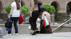 Homeless beggar Bulgarian flag Stock Footage