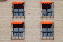 Facade Of Building With Orange Awning - stock photo