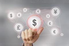 business hand pushing currency button - stock photo