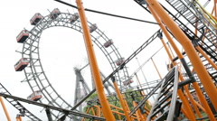 Roller coaster and large ferris wheel Prater Vienna Stock Footage