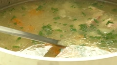 Homemade chicken soup in pot with carrots Stock Footage