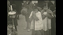 Vintage 16mm film, Columbia 1938, alter boys leading procession Stock Footage