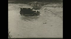 Vintage 16mm film, Columbia 1938, car crossing river Stock Footage