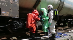 Toxic chemicals acids emergency team near train Stock Footage