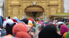 Group of people in front of Golden temple, back side view of covered heads. Stock Footage