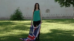 Casual girl having fun with GB flag Stock Footage