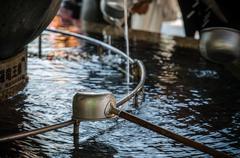 A water ladle at the purification pavilion (a chozuya or temizuya) - stock photo