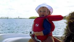 Cute baby's first time on a boat, 4K Arkistovideo