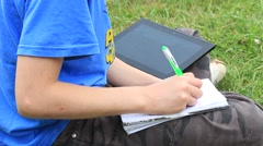 Person Studying With Tablet PC at park. Stock Footage