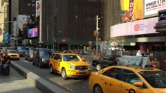 Vehicles move along Broadway in Times Square in New York City. - stock footage