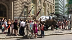 Tourists gathered around the Charging Bull Stock Footage