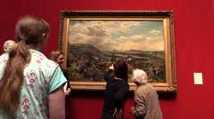 At the art gallery . Visitors admiring paintings and works of art Stock Footage