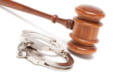 Gavel and Handcuffs Isolated on a White Background. - stock photo