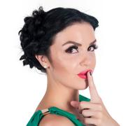 Pretty woman making a keep it quiet gesture Kuvituskuvat