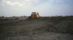 Earthworks with bulldozers, long shot, pan left - stock footage