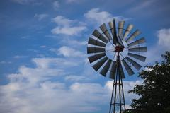 Majestic Windmill Against a Deep Blue Sky and Whispy Clouds With Room For Tex Stock Photos