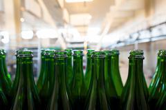 Many bottles on conveyor belt Stock Photos