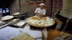 Ladies cooking gozleme in taksim Beyoglu. - stock footage