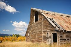 Rustic Barn Scene with Deep Blue Sky and Clouds Stock Photos