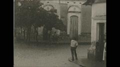 Vintage 16mm film, Columbia 1938, man crossing flooded street, swimming Stock Footage