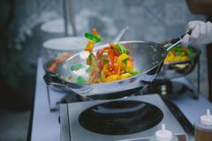 cooking vegetables in wok pan - stock photo
